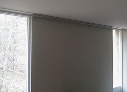 Wall Between Windows Without Curtains: