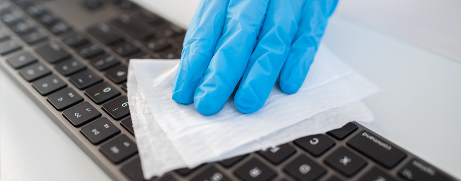 cleaning and sanitizing office keyboard