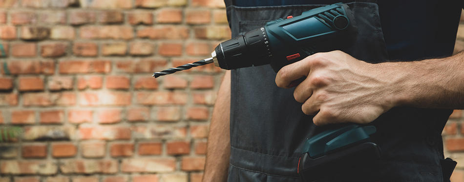 Man holding a cordless drill