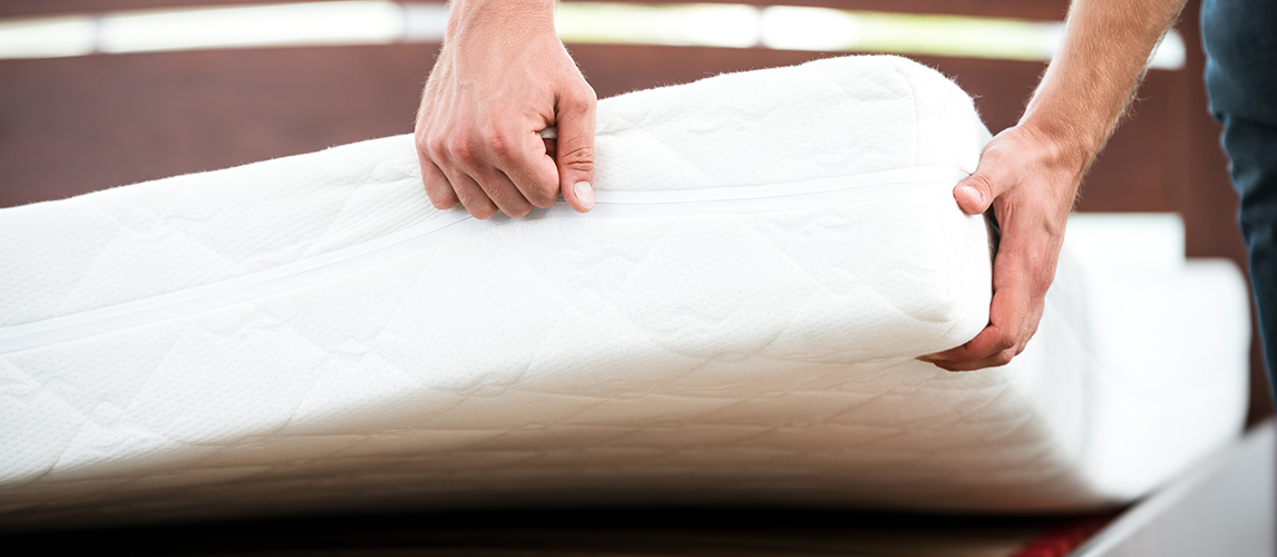 Man near white mattress