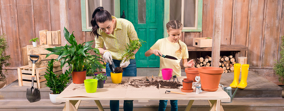 Mother and daughter with plants