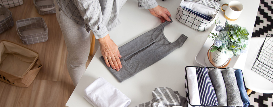Woman folding her clothes