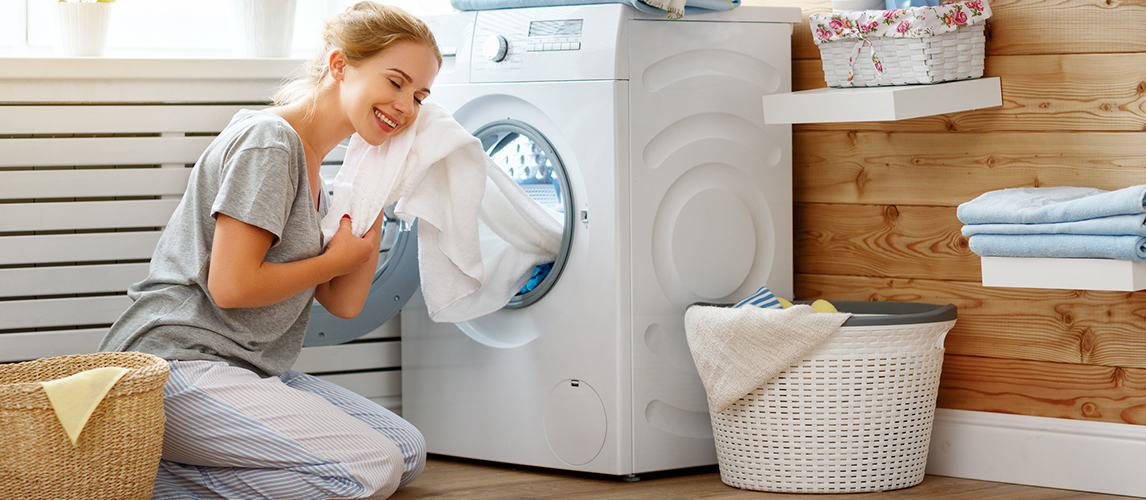Woman in laundry room with washing machine