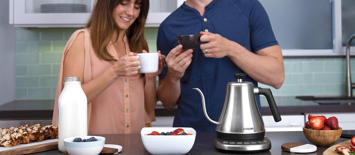 couple with electric kettle
