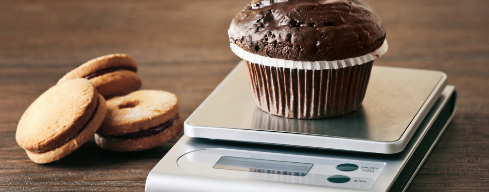 digital kitchen scale and chocolate