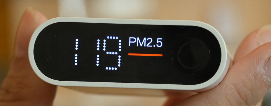 holding air quality monitor