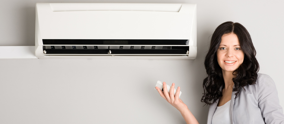 woman setting mini split ac